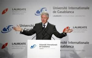 Former U.S. President Bill Clinton speaks during a news conference at the international university in Casablanca