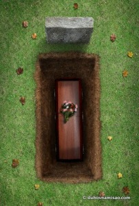 Coffin in Open Grave --- Image by © Daniel Smith/Corbis