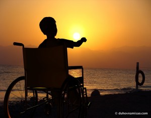 kid-in-wheelchair-at-the-beach-in-sunset1